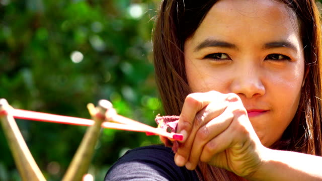 young asian woman aiming slingshot - catapult stock videos & royalty-free footage