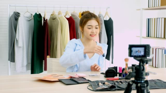 young asian woman beauty blogger showing cosmetic while recording how to make up video tutorial by camera, vlog concept, beauty and fashion people and technology communication - subscribe stock videos and b-roll footage