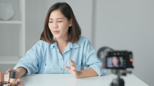 young asian woman beauty blogger showing cosmetic while recording how to make up video tutorial by camera, vlog concept, beauty and fashion people and technology communication - tutorial stock videos and b-roll footage