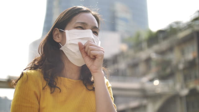 young asian woman cough with face mask protection - pollution mask stock videos & royalty-free footage