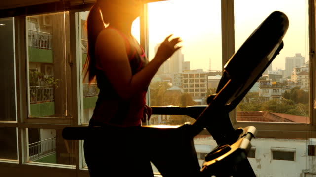 young asian woman exercising on a treadmill - treadmill stock videos & royalty-free footage