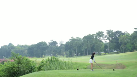 young asian woman hits the perfect golf shot - golfer stock videos & royalty-free footage