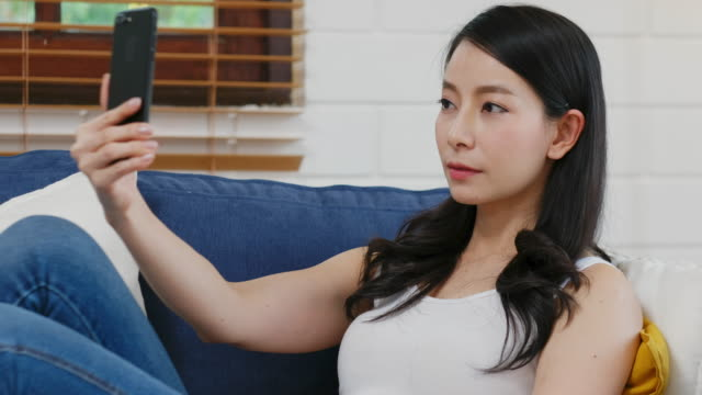 young asian woman holding smart phone as biometric verification and face detection, innovations and technology, people and technology lifestyle - verification stock videos & royalty-free footage