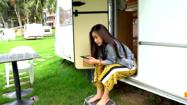 young asian woman in a camper van - convoy stock videos & royalty-free footage