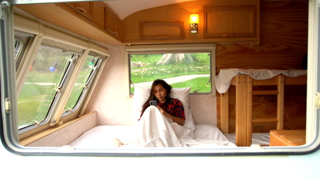 young asian woman in a camper van - camper van stock videos & royalty-free footage