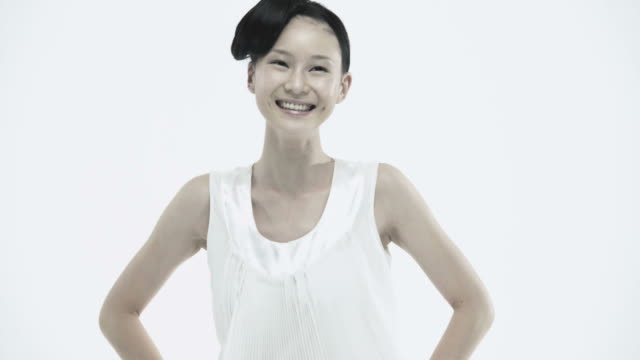 Young asian woman laughing