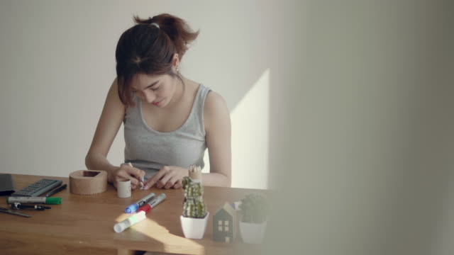 young asian woman repairing a clock for diy - diy stock videos & royalty-free footage