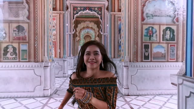 young asian woman running at patrika gate, jaipur, rajasthan, india - gate stock videos & royalty-free footage