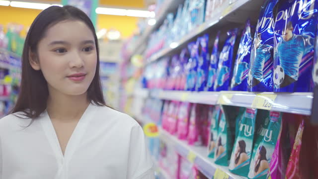 young asian woman shopping - east asian ethnicity stock videos & royalty-free footage