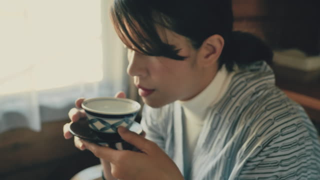 young asian woman sipping hot tea ceremony - sustainable tourism stock videos & royalty-free footage