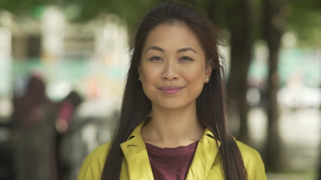 Young Asian woman to camera