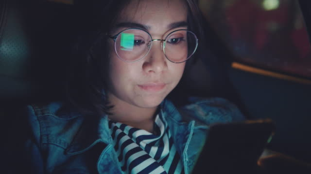 young asian woman using a smart phone in the car. - after work stock videos & royalty-free footage