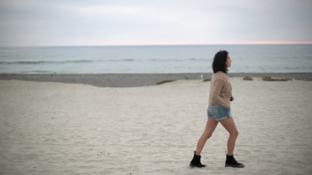 WS Young Asian woman walking on the beach.