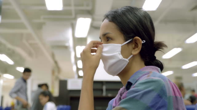 young asian woman wearing face mask protection feel sick and cough at public place. - facial tissue stock videos & royalty-free footage