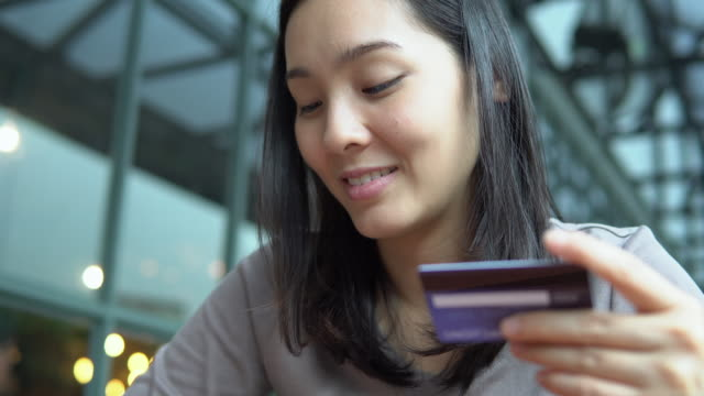 young asian woman with credit card - organisation stock videos & royalty-free footage
