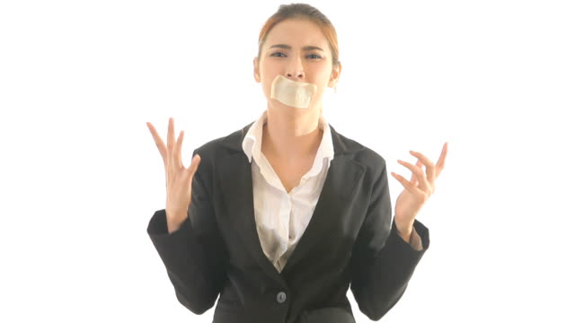 Young asian woman with tape on her mouth
