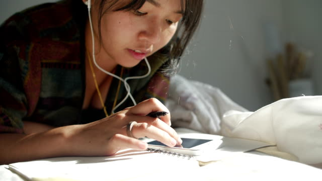 Young asian women listening to music