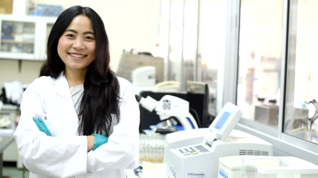 young asian women scientist smiling in laboratory - stem topic stock videos & royalty-free footage