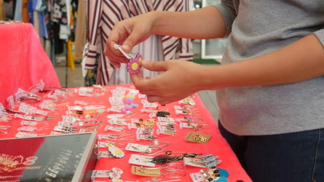 young Asian women  shopping at street market