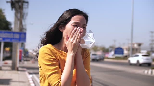 young asian women sneezing outdoor - only young women stock videos & royalty-free footage