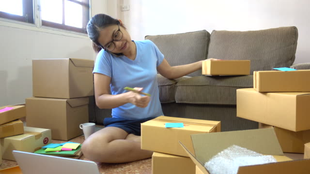 young asian women using phone to check e-mail inbox order from the customer - selling stock videos and b-roll footage