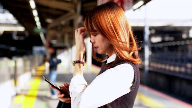 young asian women using the mobile phone during transportation. - on the move stock videos & royalty-free footage