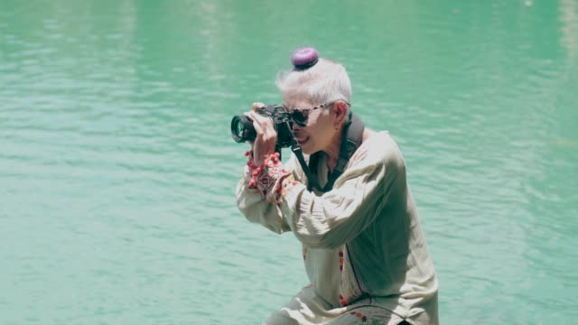 young at heart of hipster photographer 60+ - young at heart stock videos & royalty-free footage