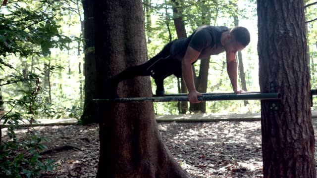 young athlete doing pull ups in the park - pull ups stock videos & royalty-free footage