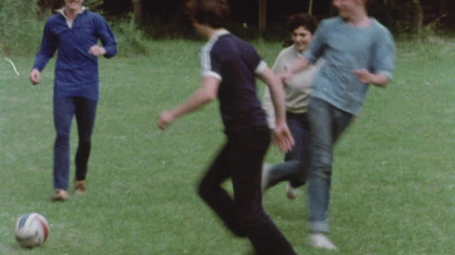 1978 ts young athlete tripping and falling during a soccer game, then retiring from the field / united kingdom - reportage stock videos & royalty-free footage