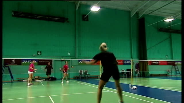 vídeos de stock, filmes e b-roll de young athletes compete for funding for next olympic games england buckinghamshire milton keynes int wide shot of people playing badminton on courts... - badmínton esporte