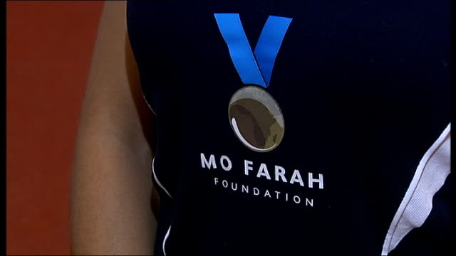 young athletes on scholarship at the mo farah academy diana nell interview sot mo farah poster on wall close up shot 'mo farah foundation' sports... - sports poster stock videos & royalty-free footage