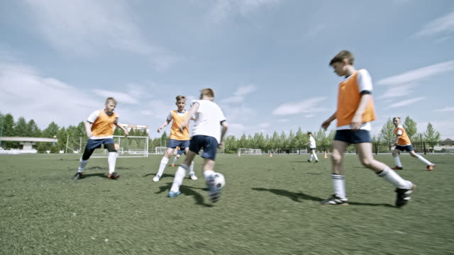 young athletes playing professional soccer on field - adolescence stock videos and b-roll footage