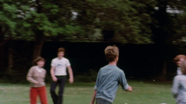 1978 ts young athletes playing soccer in a field beside a building / united kingdom - 1978 stock videos and b-roll footage
