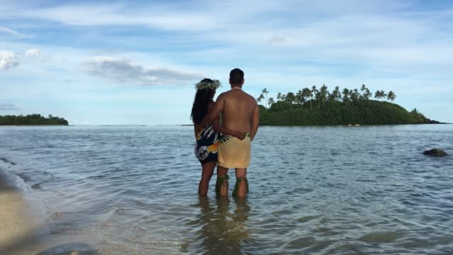 Young attractive and exotic Pacific Islander honeymoon couple at Muri lagoon in Rarotonga Cook Islands