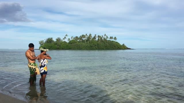 Young attractive and exotic Pacific Islander honeymoon couple at Muri lagoon in Rarotonga Cook Islands