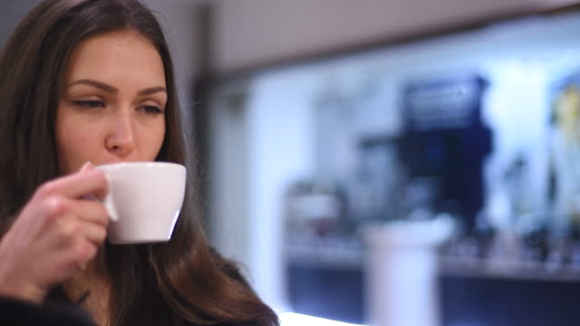 young attractive girl enjoying coffee - beautiful woman stock videos & royalty-free footage