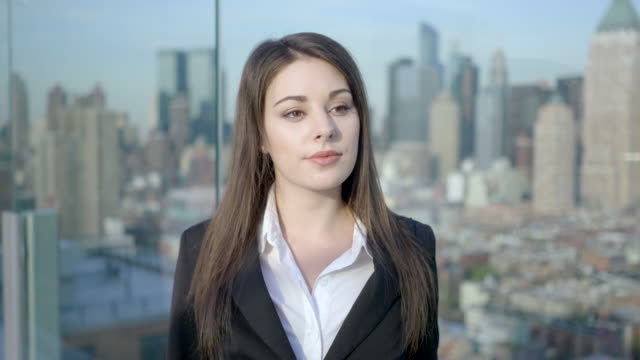 young attractive professional business women standing on modern rooftop building in the city