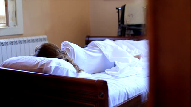 young attractive sleeping woman in bed - bathrobe stock videos & royalty-free footage