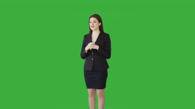 vidéos et rushes de young attractive white women isolated on green screen chroma key background. female sales business professional - rouge à lèvres rouge