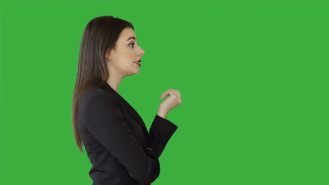 young attractive white women isolated on green screen chroma key background. female sales business professional - side view stock videos & royalty-free footage