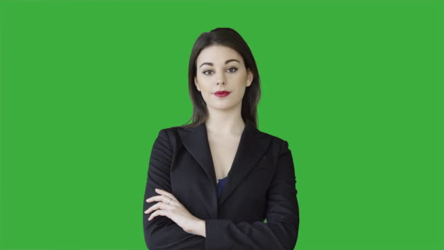 young attractive white women isolated on green screen chroma key background. female sales business professional