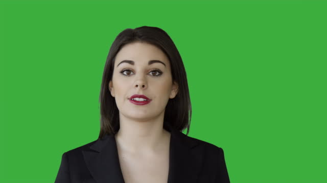 young attractive white women talking having a conversation isolated on green screen chroma key background. female sales business professional