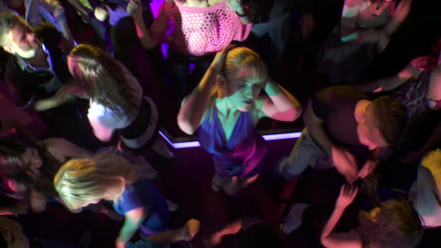 HD: Young Attractive Woman Dancing In Club