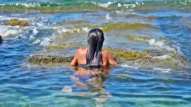 a young, attractive woman emerged in and out of the sea pool - malta stock videos & royalty-free footage
