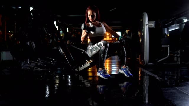 Young, Attractive Woman, Fitness Instructor, is Doing Exercises With Hand Weights