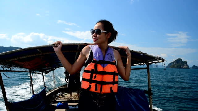 Young attractive woman in longtail boat
