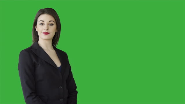 vidéos et rushes de young attractive women presenting product title with hand gesture isolated on green screen background - rouge à lèvres rouge