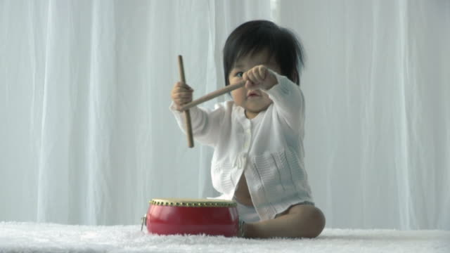 MS SLOMO Young baby with drum  holding drumsticks with hands/Singapore