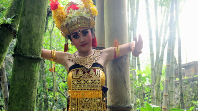 young balinese dancer performing barong dance in a bamboo forest - balinese culture stock videos & royalty-free footage