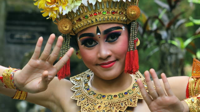 young balinese dancer performing barong dance in a hindu temple - bali stock videos & royalty-free footage
